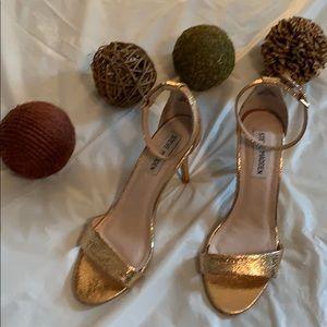 Steve Madden rose gold heels.
